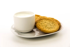 Plain sugar cookies and cup of milk Royalty Free Stock Photos