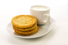 Plain sugar cookies and cup of milk Royalty Free Stock Image