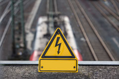 Plain train high voltage power line sign Royalty Free Stock Photography