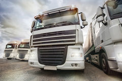 Plain truck fleet. A plain truck fleet with cloudy sky royalty free stock image
