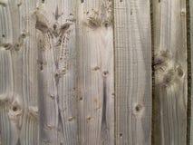 Plain unpainted wooden fence panel Stock Image