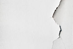Plain white background with cracked plaster. White grunge background with cracked plaster texture stock photo