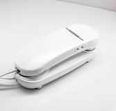 Plain white corded home telephone. Stock Photos