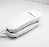 Plain white corded home telephone. Stock Photos