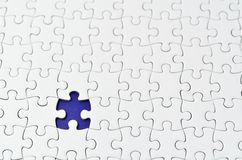 Plain white jigsaw puzzle. Stock Image