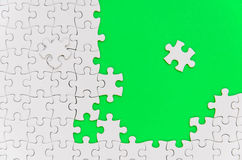 Plain white jigsaw puzzle. Royalty Free Stock Photo