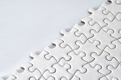 Plain white jigsaw puzzle Royalty Free Stock Photo