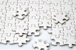 Plain white jigsaw puzzle Royalty Free Stock Image