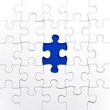 Plain white jigsaw puzzle, on Blue background Stock Photos