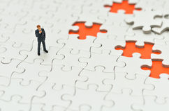 Plain white jigsaw puzzle and Businessman. Royalty Free Stock Images