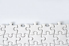 Plain white jigsaw puzzle Stock Photos