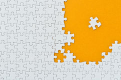 Plain white jigsaw puzzle. Stock Images