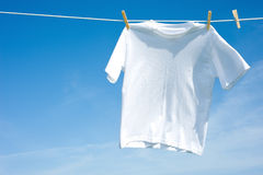 Plain White T-Shirt on a Clothesline stock photo