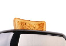 Plain white toast popping up from a toaster Stock Images