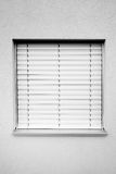 Plain Window with Blind. A high contrast black and white image of a plain window with a drawn down blind shade Royalty Free Stock Photos