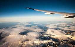 Plain wing over the France alps Stock Image