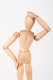 Plain wood mannequin stand upright holding head Royalty Free Stock Images