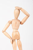 Plain wood mannequin stand upright holding head Stock Image