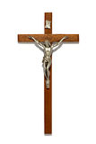 Plain wooden crucifix with silver figure of Christ Royalty Free Stock Photos