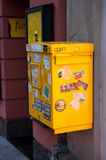 Plain yellow mailbox Royalty Free Stock Photos