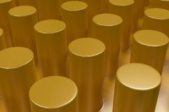 Plain yellow surface with cylinders Royalty Free Stock Photos