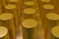 Plain yellow surface with cylinders Royalty Free Stock Photography