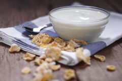 Plain yogurt in small glass bowl with crispy cereal. On cotton cloth place on old wood background. white yoghurt. plain yogurt. yoghurt Royalty Free Stock Photos