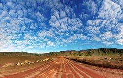 Plaine des Sables landscape. Dirt road on volcanic landscape of Plaine des Sables, Reunion Island National Park Royalty Free Stock Image