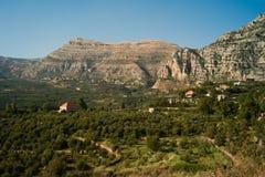 Plaine et village d'Aqoura Image libre de droits