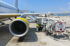 Plaine receiving fuel from tanker truck. BARCELONA- AUGUST 5: Airbus A320 of the Vueling Airlines receiving fuel from tanker truck at Barcelona International Royalty Free Stock Images