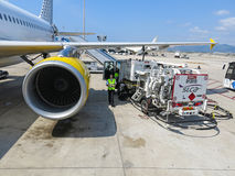 Plaine receiving fuel from tanker truck. BARCELONA- AUGUST 5: Airbus A320 of the Vueling Airlines receiving fuel from tanker truck at Barcelona International Stock Photos