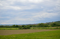 Plains and Arable Land. Under cloudy sky in spring Royalty Free Stock Photography