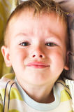 Plaintive cute little boy Stock Photo