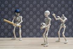 Plaisanterie de base-ball de squelettes Photographie stock libre de droits