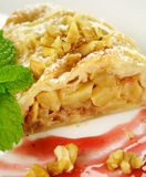 Plaited Apple Pie. Delicious fresh baked plaited apple pie with walnuts ready to serve royalty free stock photos