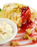 Plaited Apple Pie. Delicious fresh baked plaited apple pie with raspberry sauce and walnuts ready to serve Stock Images