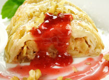 Plaited Apple Pie. Delicious fresh baked plaited apple pie with raspberry sauce and walnuts ready to serve royalty free stock photos