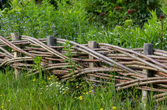 Plaited fence on countryside on Maramures, Romania. Traditional wooden fence from Maramures, Romania Stock Photo