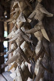 Plaited palm leaves and hand painted fish mobile Royalty Free Stock Photos