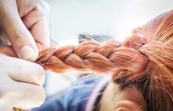 Plaiting hair Stock Photos
