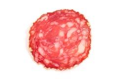 Plak van salamiworst op een witte achtergrond Royalty-vrije Stock Fotografie