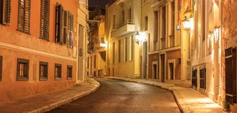 Plaka by night, Athens, traditional buildings at the sides of a street. Architecture in Greece. royalty free stock photo