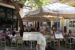 The Plaka is the oldest section of Athens. Area of restaurants, Jewelry stores tourist shops, and cafes. Royalty Free Stock Photo
