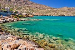 Plaka town at the sea on Crete, Greece. Turquise water of Mirabello bay in Plaka town on Crete, Greece Stock Photos