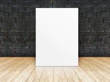 Plakat rama przy czarnym ściana z cegieł i drewnianą podłoga zdjęcie stock