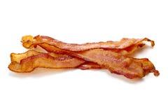 Plakken van bacon op wit Stock Foto