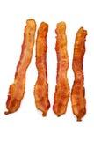 Plakken van bacon op wit Stock Fotografie