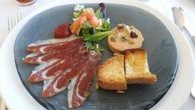 Plakken van ham en foie met noten royalty-vrije stock foto's