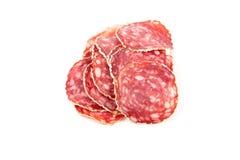 Plakken van salamiworst op een witte achtergrond Royalty-vrije Stock Foto