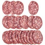 Plakken van salamiworsten op een witte achtergrond worden geïsoleerd die Royalty-vrije Stock Foto